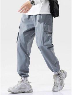 Men Side Flap Pocket Drawstring Hem Cargo Pants
