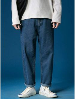 Men Solid Tapered Jeans