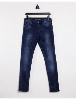 Elevate super skinny jeans in clean blue vintage