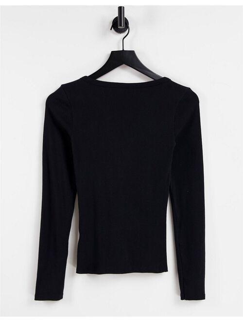 Guess long sleeve v neck logo henley top in black