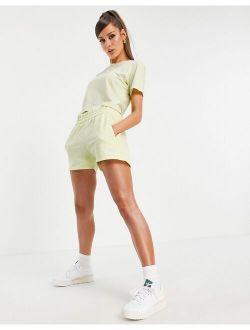 Originals Tennis Luxe logo 3-Stripes high waist shorts in hazy yellow