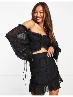 textured chiffon crop top with button front detail in black - part of a set
