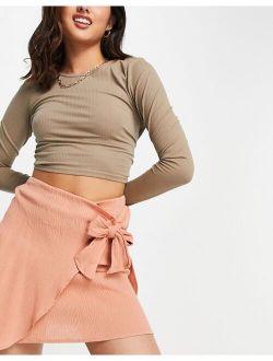 wrap mini skirt in natural crinkle in terracotta