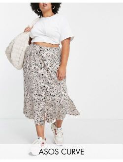 Curve button up midi skirt with deep pocket detail in animal print